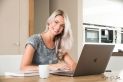 girl on laptop in kitchen