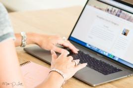 Girl on laptop making blog