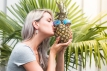 Girl kiss pineapple